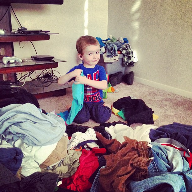 Well, at least he's trying to fold clothes.