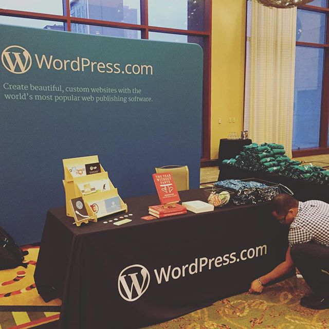 David Cole finishing setting up the WordPress.com booth at An Event Apart Austin 2015.