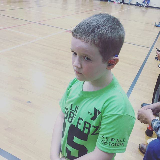 First basketball game. I had just gotten on to him for running across the court while he was supposed to be on the bench.