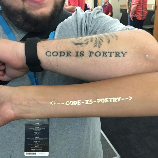"Josepha and I showing off our ""Code is Poetry"" tattoos. 👌 #wcokc"