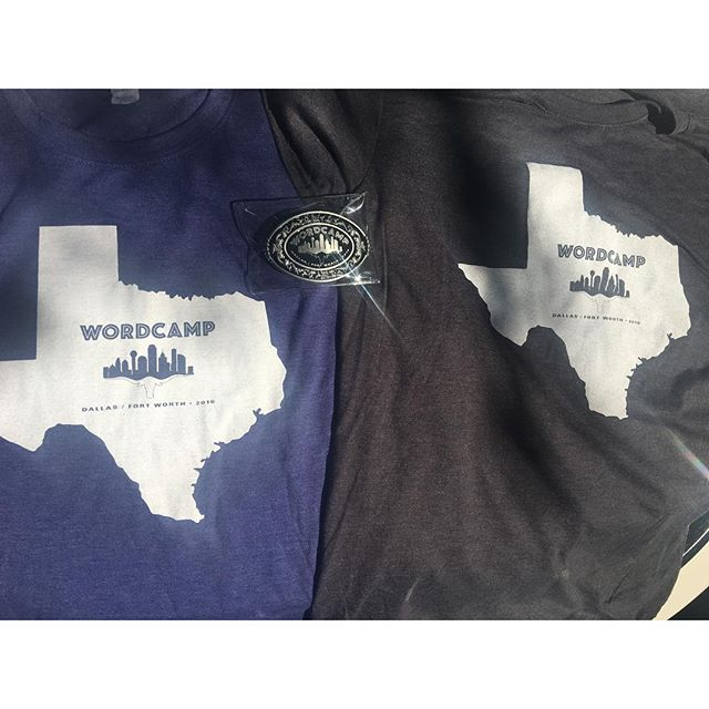 #wcdfw swag. Blue volunteer shirts, grey attendee shirts, and belt buckles for speaker gifts.