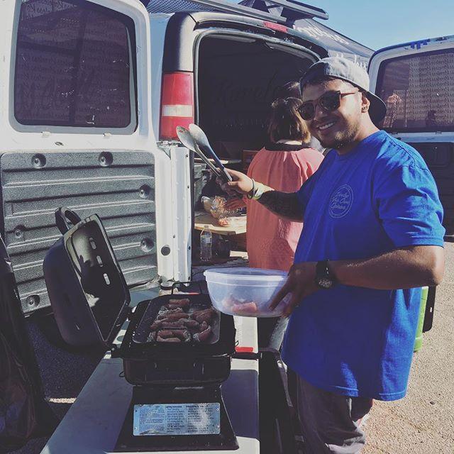 Tacos being grilled up behind the @karelessoriginal van. #karelessfamily